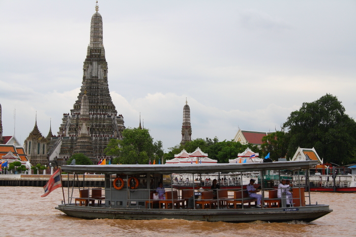 Ferry on the Chao Phraya River at Wat Arun in Bangkok, Thailand