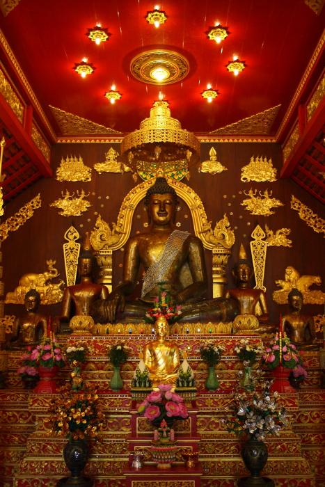 Bronze Buddha at Wat Phra Kaew in Chiang Rai, Thailand