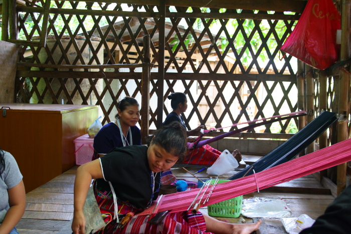 White Karen women making garments near Chiang Mai, Thailand